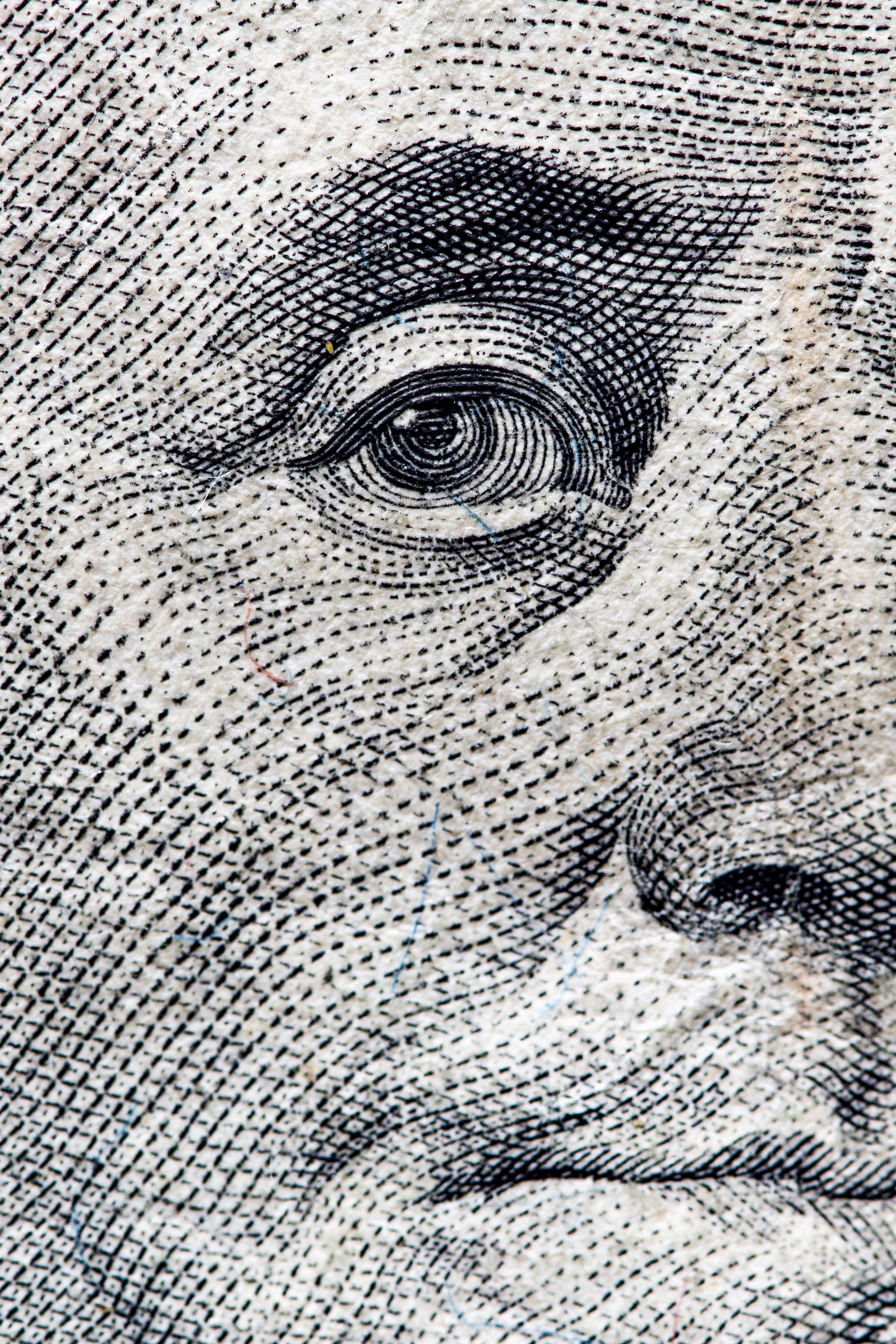 Close-up of George Washington's eye on the U.S. one dollar bill